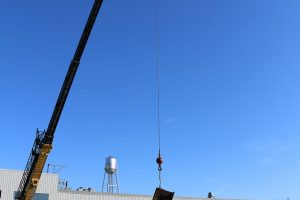 Crane lowering the beam into place